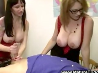 large titted matures are tugging a cock