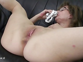 older mamma riding a sextoy on her daybed