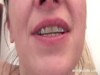 redhead aged rubbing her pussy and milk sacks in