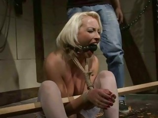 mature blonde receives bondaged and punished
