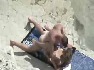 aged beach fuck movie scene of couple caught on
