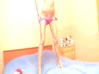 stunnigly slender gal stripping for a web camera