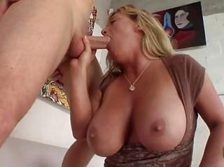 heavy chested tanned blonde momma sucks stiff