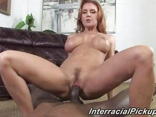 aged brunette with great pantoons rides black