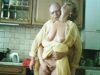 mom and daddy having enjoyment in the kichten.