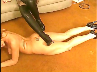 lesbo receives s garb and licks high heeled boots