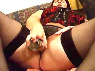 plump wife joan fucking herself on the bed