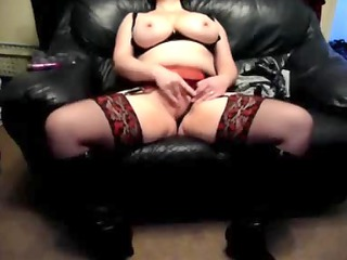 lustful wife on a leather couch at home