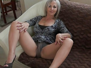 stylish blonde momma in hose does striptease