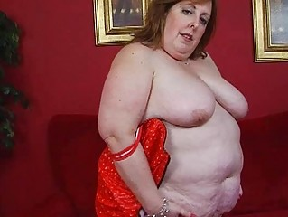 mature chunky momma in corset sticks sex toy up