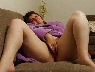 chubby wife joanne rubs pussy on sofa