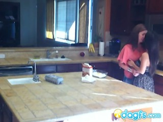 slutty milf eats teen pussy in the kitchen