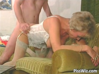 aged whore in white lingerie getting