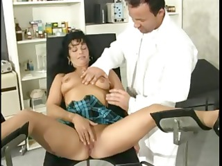 hot dark brown milf slurps on the doctors schlong