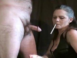 hot mature female always smokes her cigarette