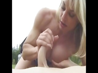 mature muscled with large love button outdoors