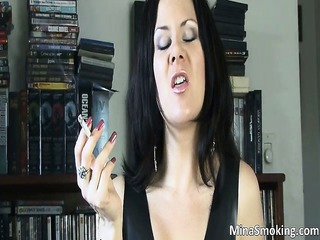 naughty brunette hair playgirl smokes a cigarette