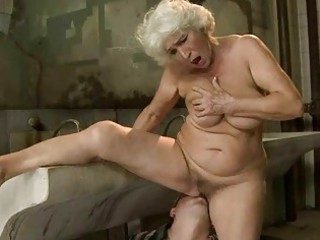 breasty granny receives screwed in public latrine