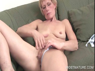 aged blondie fingering pussy