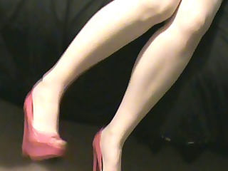 wife in a pink corset pink nylons and high heels