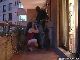 brazilian older sweetheart lazily sucking a knob