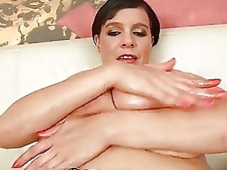 mature laurella playing with her huge tits