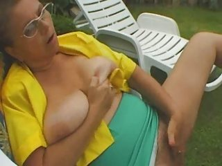 redhead granny sucks a big cock in the garden