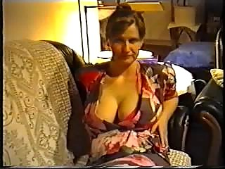 wife flashing large milk shakes in a brassiere