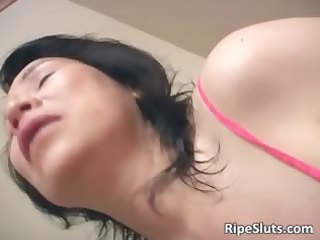 aged asian slut masturbates as she is