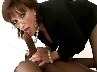 older whore in glasses and pearls has some