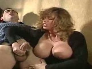 huge-boobed-milf-gives-sloppy-handjob
