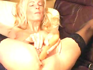 mature blond plays with big toy